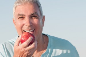 Denture Patient Biting Apple